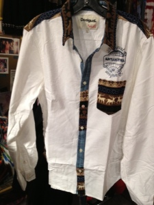 """This Desigual shirt is called Pole and has """"Antarctica"""" emblazoned above the pocket; the pocket, collar and button-up strip in front have a contrasting pattern that includes images of elk (or are they reindeer?)"""