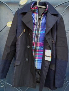 This is a new Desigual jacket that has double-breasted buttons, zip pockets in front and has a snappy blue-plaid vest that is removable.