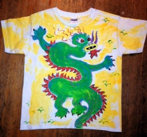 I recently painted this kids dragon shirt for a customer.