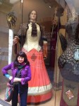 Barcelona.Jackie.in.front.of.giant.figures.from.1800s.2.2014