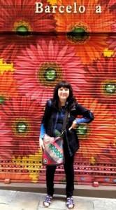 Barcelona..Jackie.in.front.of.painted.door.shop.2014
