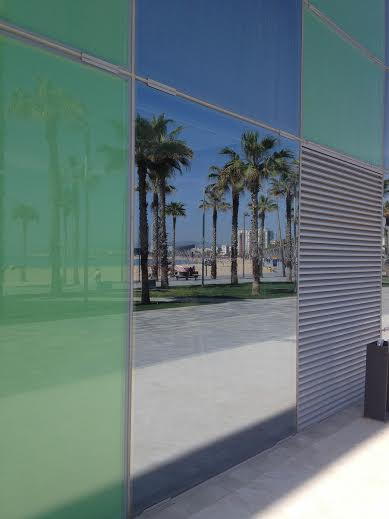 Barcelona.window.reflecting.beach.at.Desigual.HQ.2014