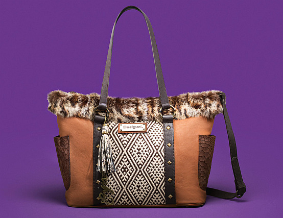 Desigual SAINT TROPEZ ANIMAL bag. Handcrafted leather with tribal details. Was $584. Now on sale for $409 (30% off). We have dozens of other Desigual bags under $100.