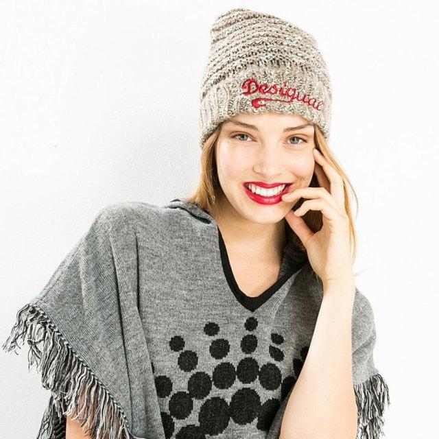 Desigual model wearing BASICO hat. $46.