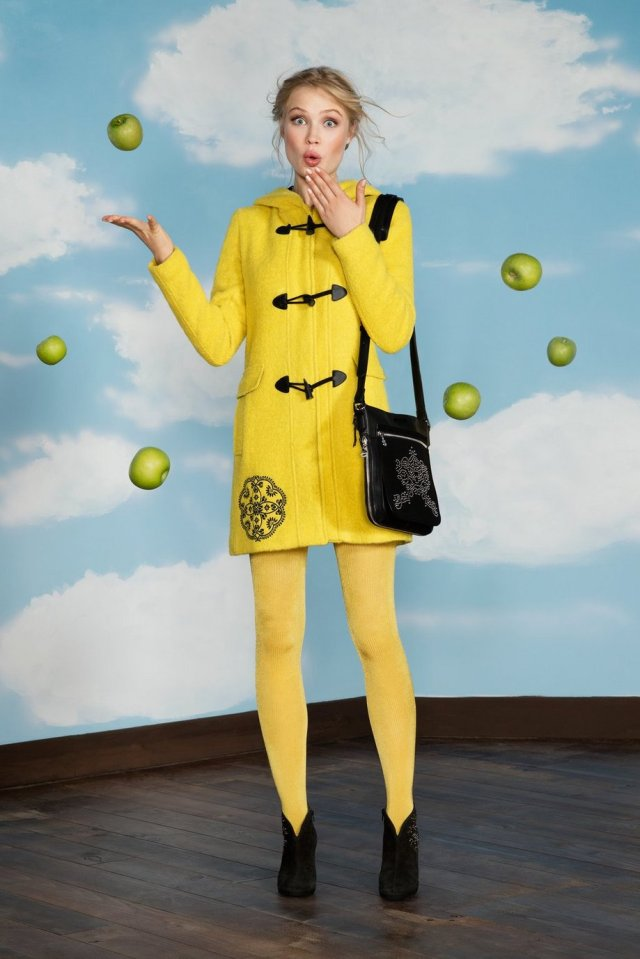 Desigual YELLOW EXPLOSION duffel coat designed by Christian Lacroix. It's warm but made of light-weight wool-alpaca wool. It has 4 pockets, a hood and black-and-white lining. $365.95.