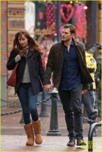 jamie-dornan-dakota-johnson-hold-hands-06