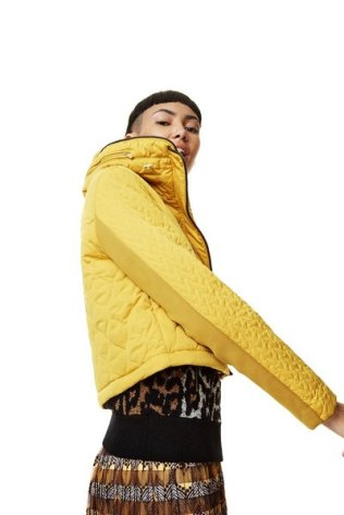Shwong bomber style jacket with coat unzipped. Desigual CALIFORNIA coat. Mellow yellow, zip pockets and removable faux fur collar lining. Unzip the bottom part of the coat and it transforms into a bomber-style jacket. $425.95.Fall-Winter 2017.